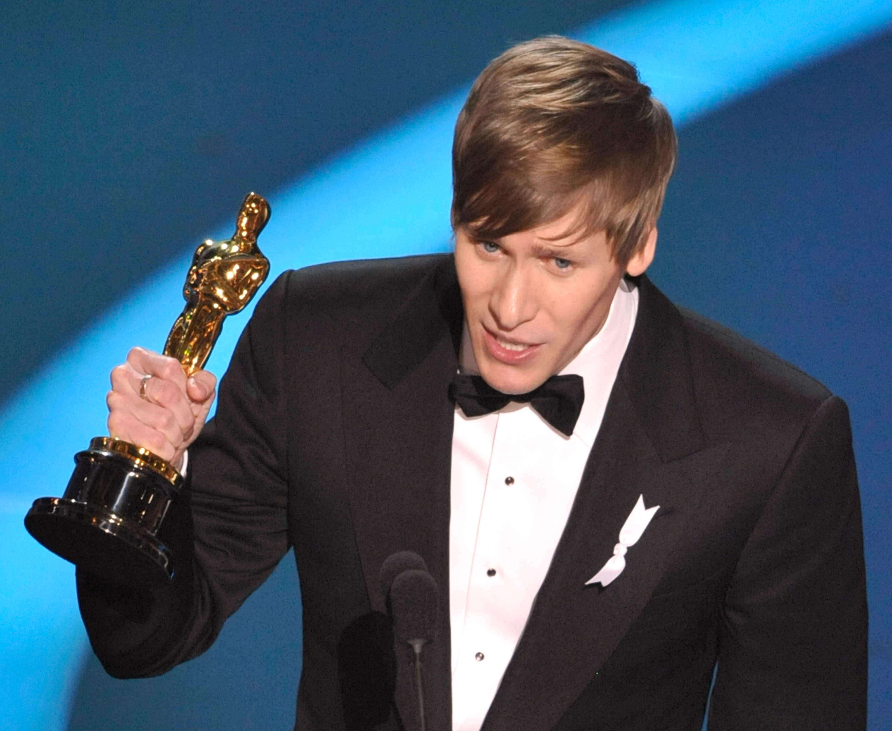 "LOS ANGELES, CA - FEBRUARY 22:  (EDITORS NOTE: NO ONLINE, NO INTERNET, EMBARGOED FROM INTERNET AND TELEVISION USAGE UNTIL THE CONCLUSION OF THE LIVE OSCARS TELECAST)  Screenwriter Dustin Lance Black receives his Best Original Screenplay award for ""Milk"" during the 81st Annual Academy Awards held at Kodak Theatre on February 22, 2009 in Los Angeles, California.  (Photo by Kevin Winter/Getty Images)"